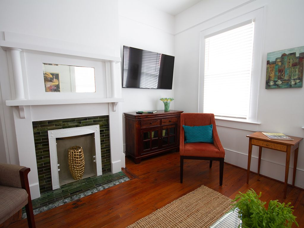Smart tv and non working fireplace in main sitting room