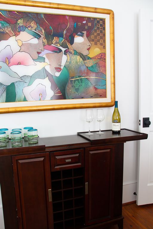Handsome bar and art in sitting room.