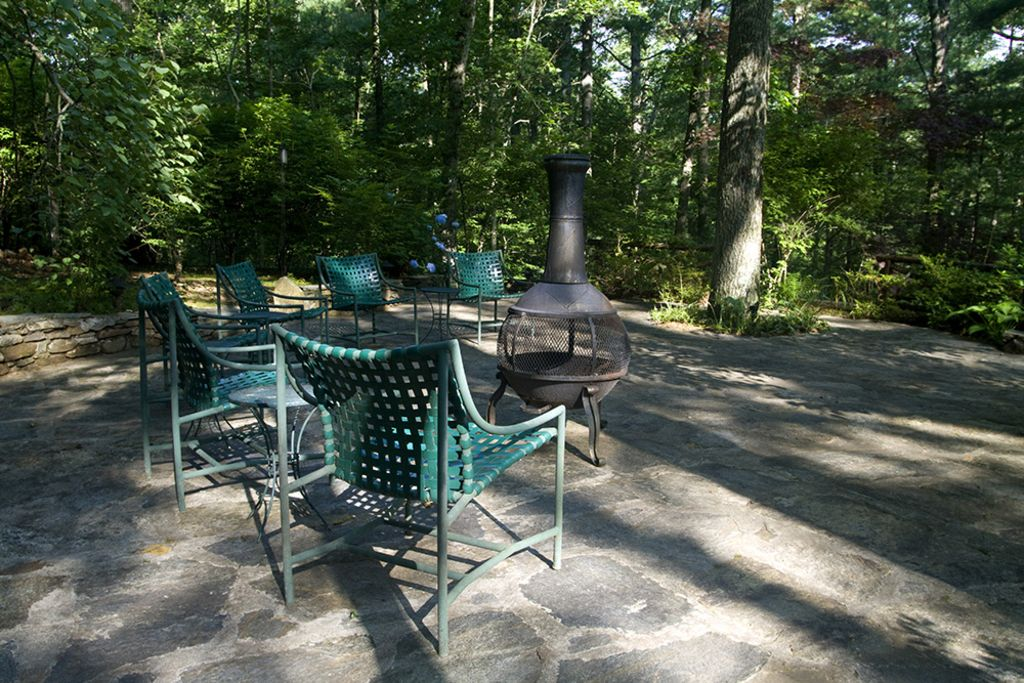 Terrace behind the house. Magical spot for drinks, outdoor dining and s'mores.