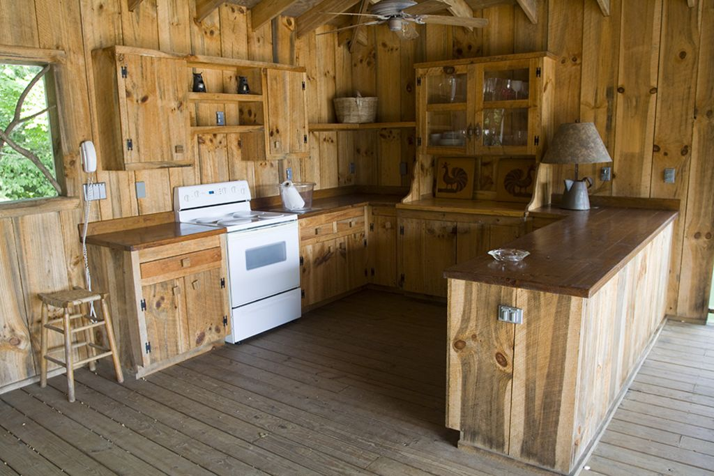 Boat house 'kitchen' opening onto large entertaining space. Easy and fun.