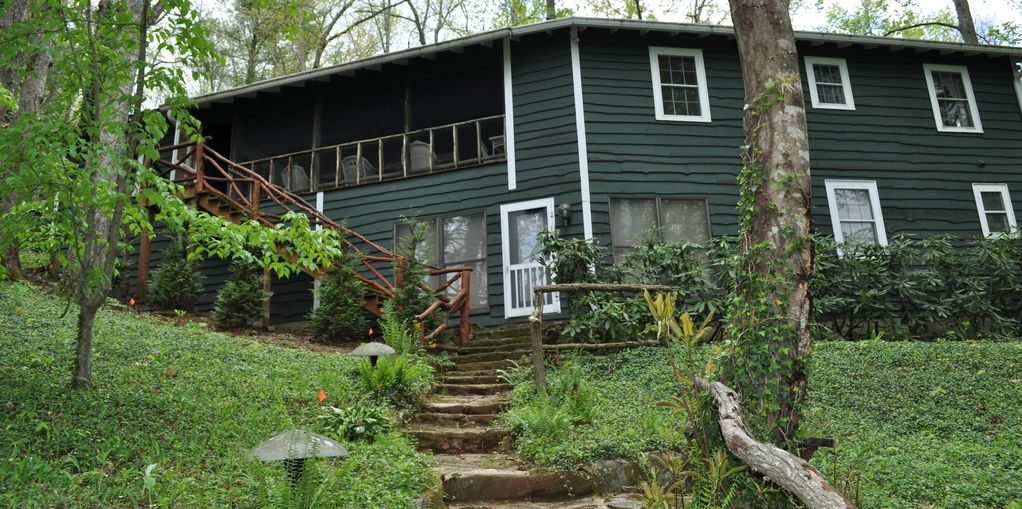 Back view of house and stairs from lake