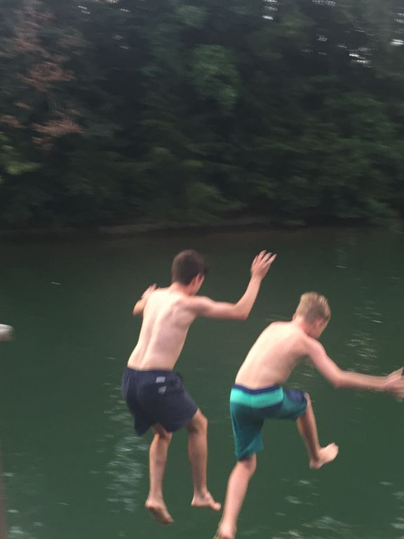 Rite of passage, uncle and nephew share the leap.