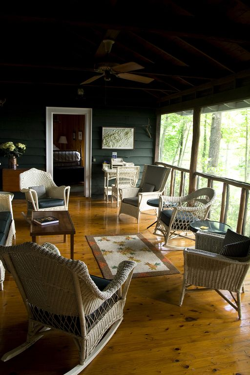 Screened porch overlooking lake, bridging bedroom #1 and the dining room.