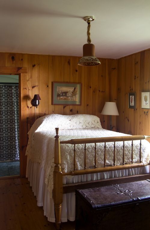 Bedroom #1, antique bed, overlooking lake and opening onto porch, large bathroom