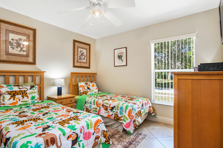 Bedroom 3 - Two Twin beds with animal theme, ceiling fan, 32