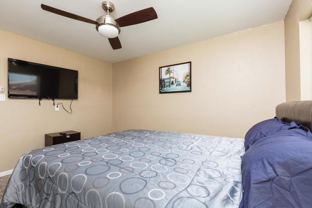 3rd Bedroom with Queen Bed and large flat screen TV