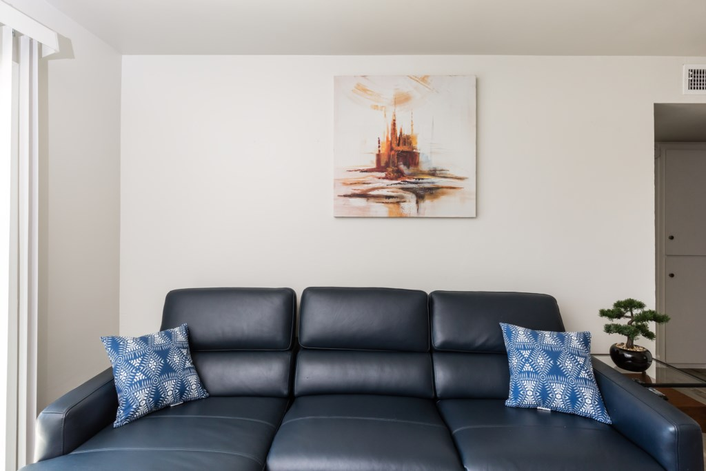 Bright open living room with large flat screen TV