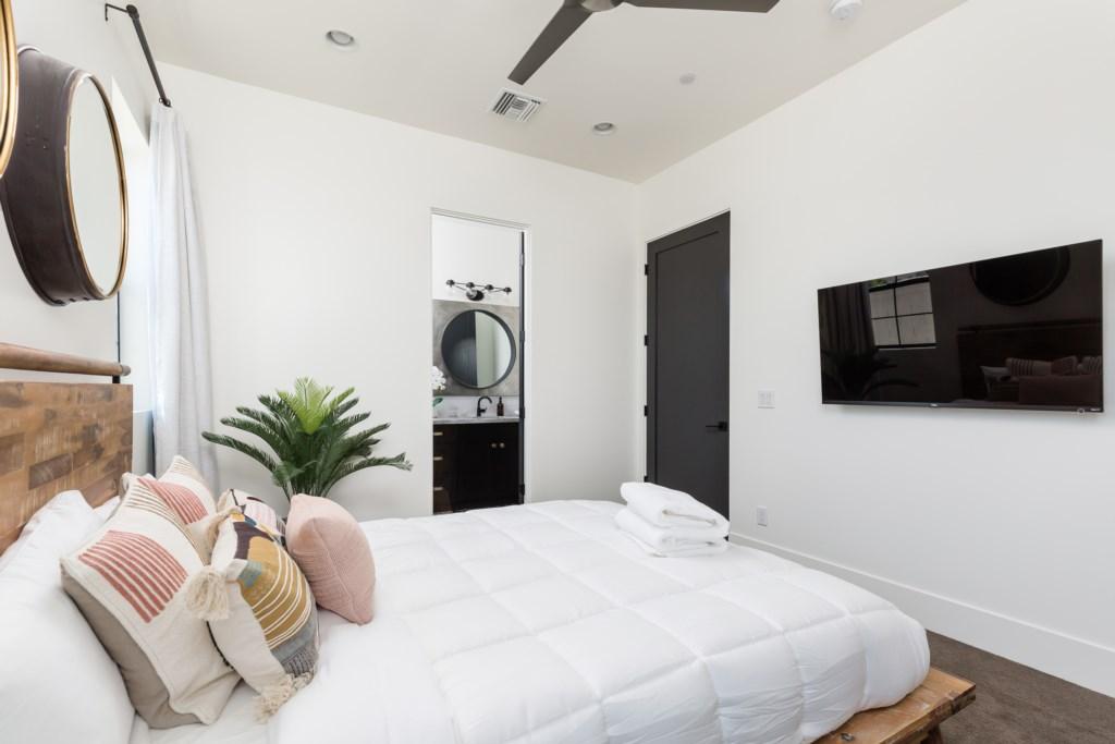 2nd bedroom with queen size bed and en-suite bathroom