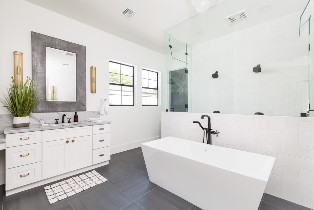 Large master bathroom with walk in shower and soaking tub