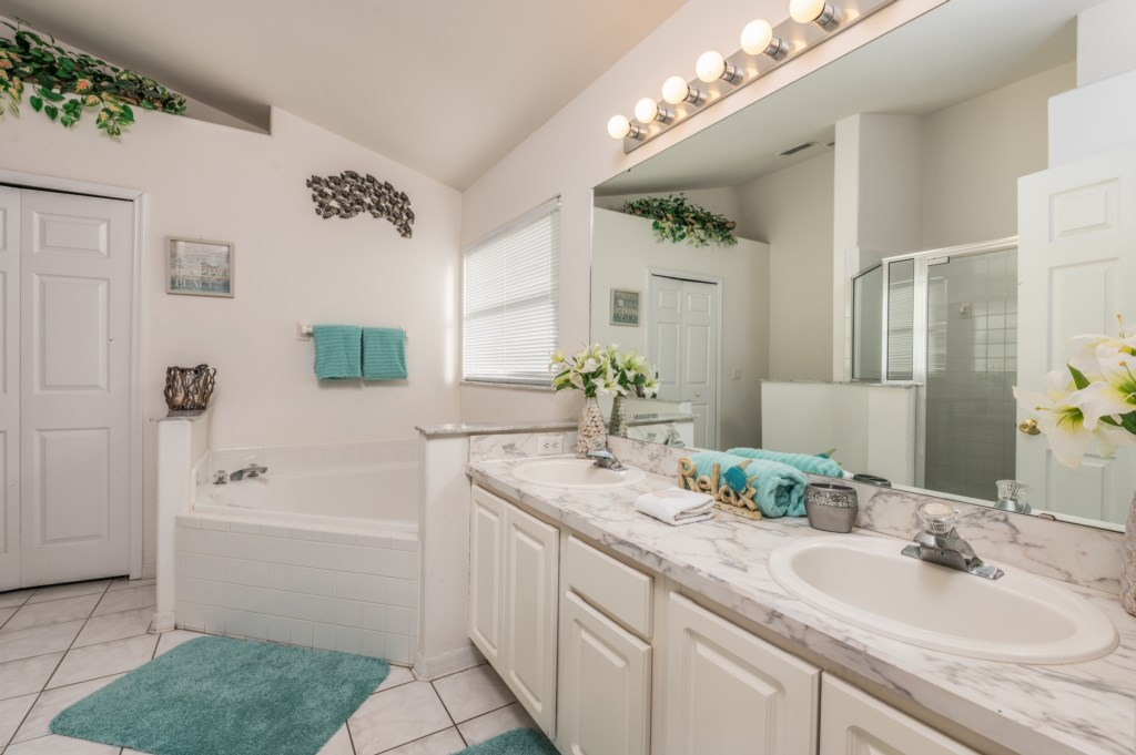 Stunning double sink vanity bathroom with tub and walk in shower