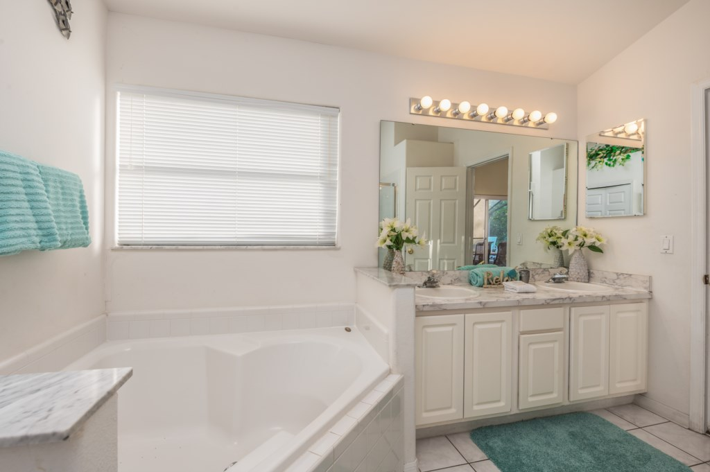 View 2 of stunning double sink vanity bathroom with tub and walk in shower