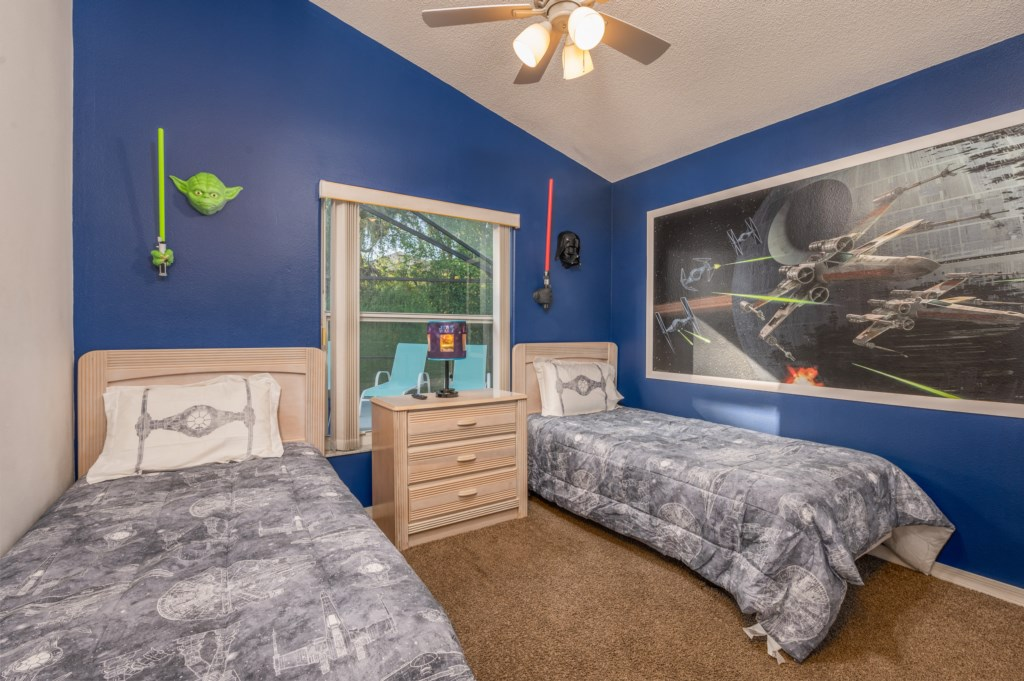 Amazing Star Wars theme room with 2 twin beds and flat screen TV