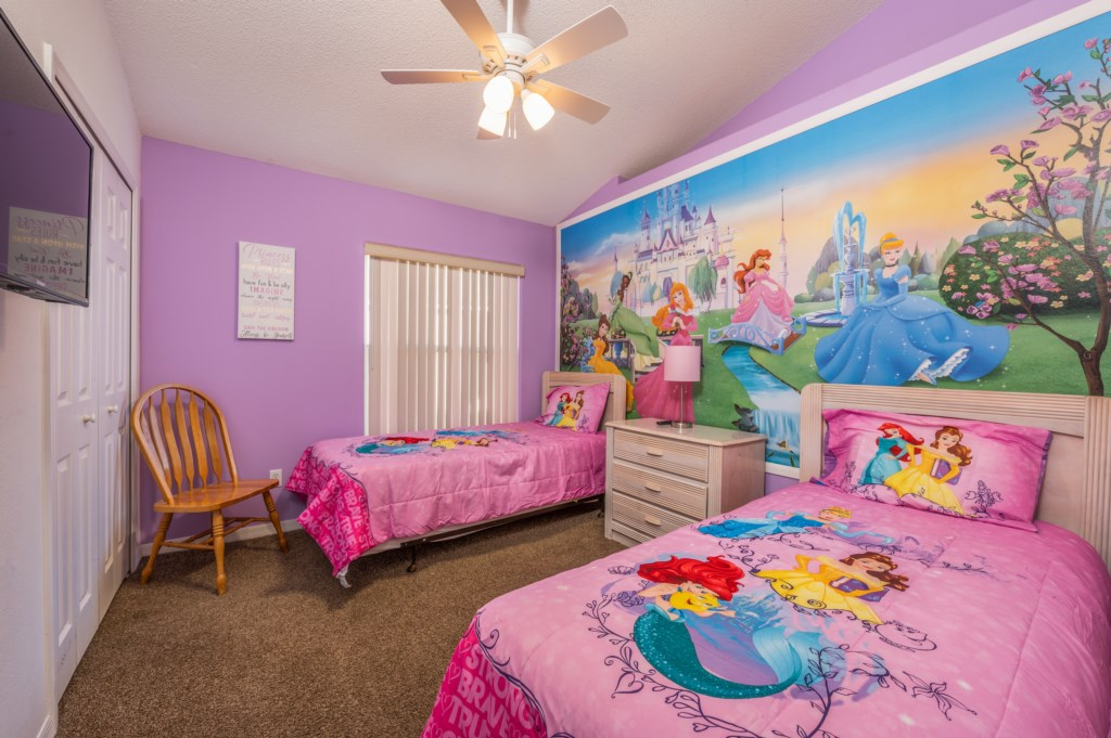 Adorable Disney Princess themed room with 2 twin beds and flat screen TV