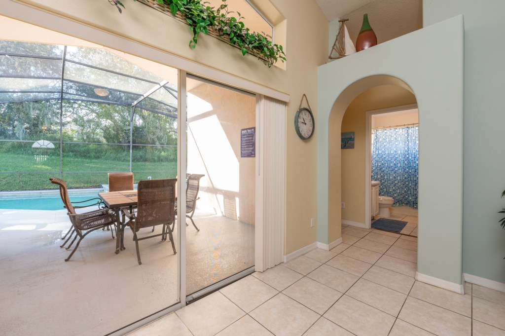 Sliding glass door to access the pool and patio area