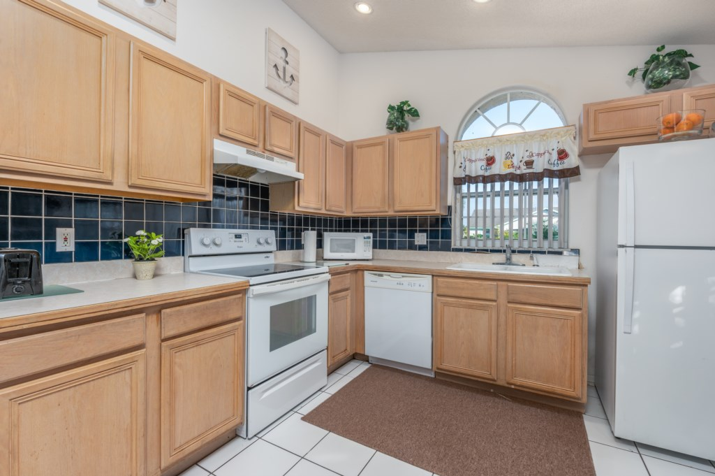 Gorgeous kitchen with toaster, oven, microwave, and dish washer