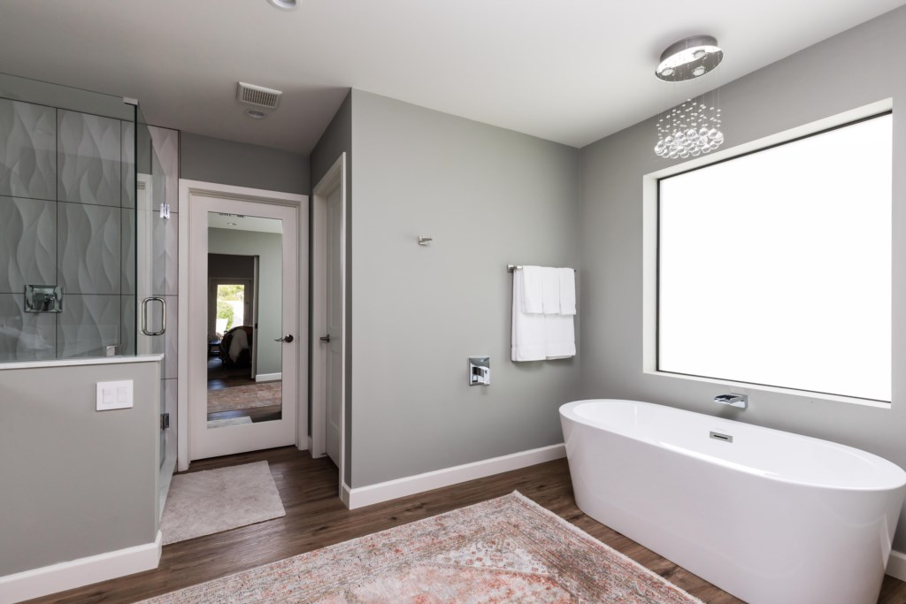 Master bathroom with bath and shower