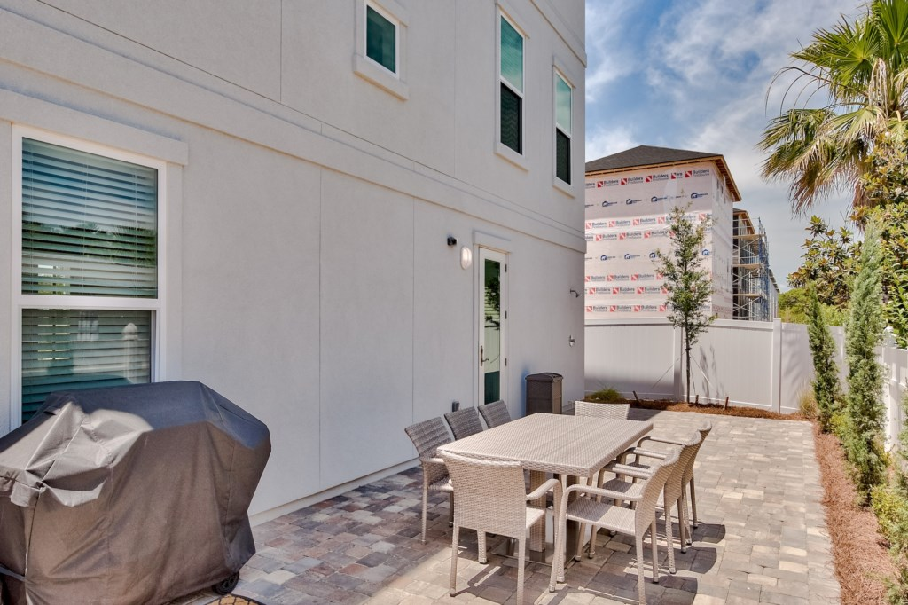 Enjoy the outdoor patio area with dining and seating