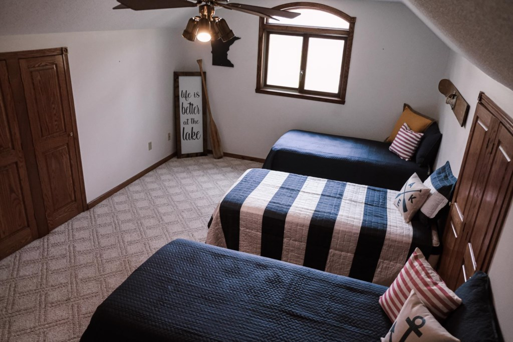 4 twin beds in this bedroom for adults or children.