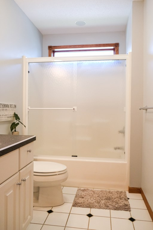Bathtub and shower combo in one of the 3 bathrooms.