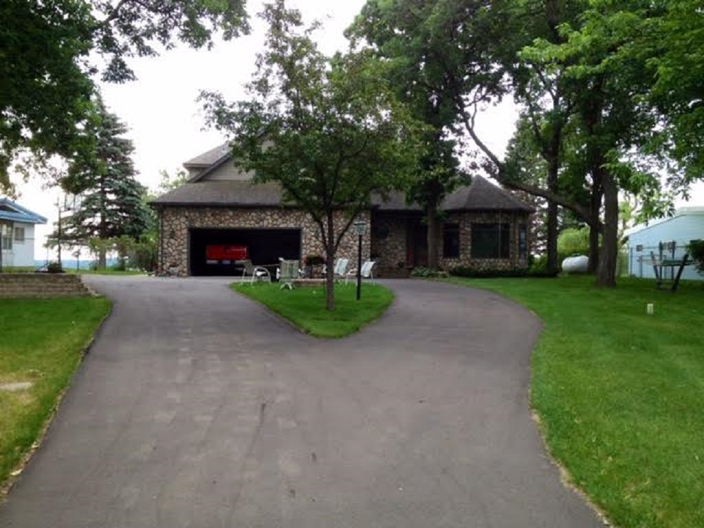 Private and gated drive with an attached 2 stall garage and a 2 stall detached garage.
