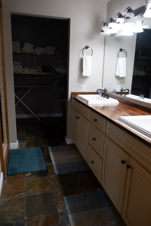 Dual vanities help provide space to get ready each morning before your lake day begins.
