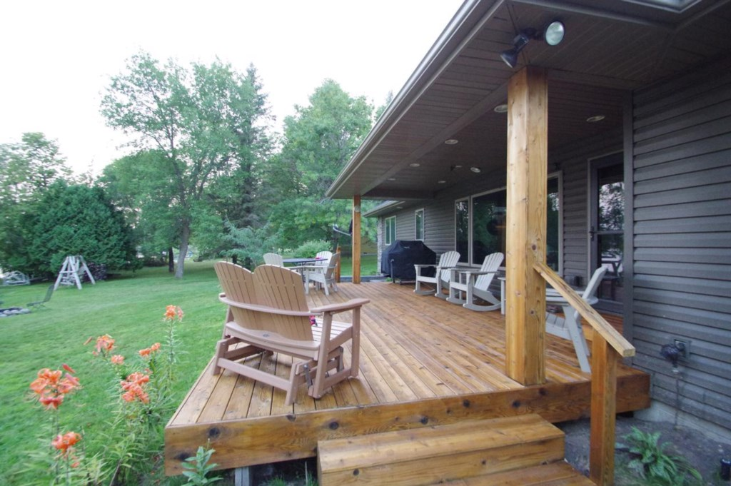 Be sure to grab a book and pull up a chair on the spacious lakeside deck.