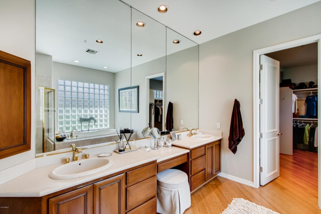 Master Bathroom with double sink vanity and large walk-in closet