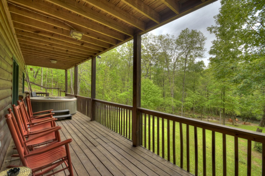 Large spacious porch with rocking chairs