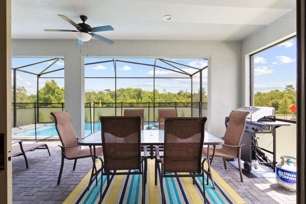 Grand patio furniture on pool deck with grill