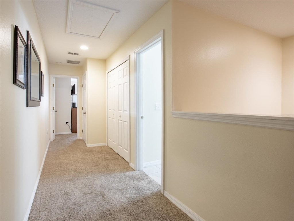 Spacious landing with storage and laundry.