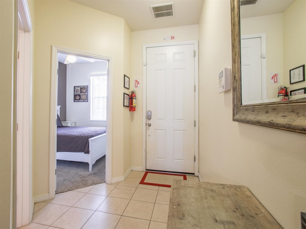 Entry way and downstairs bedroom.