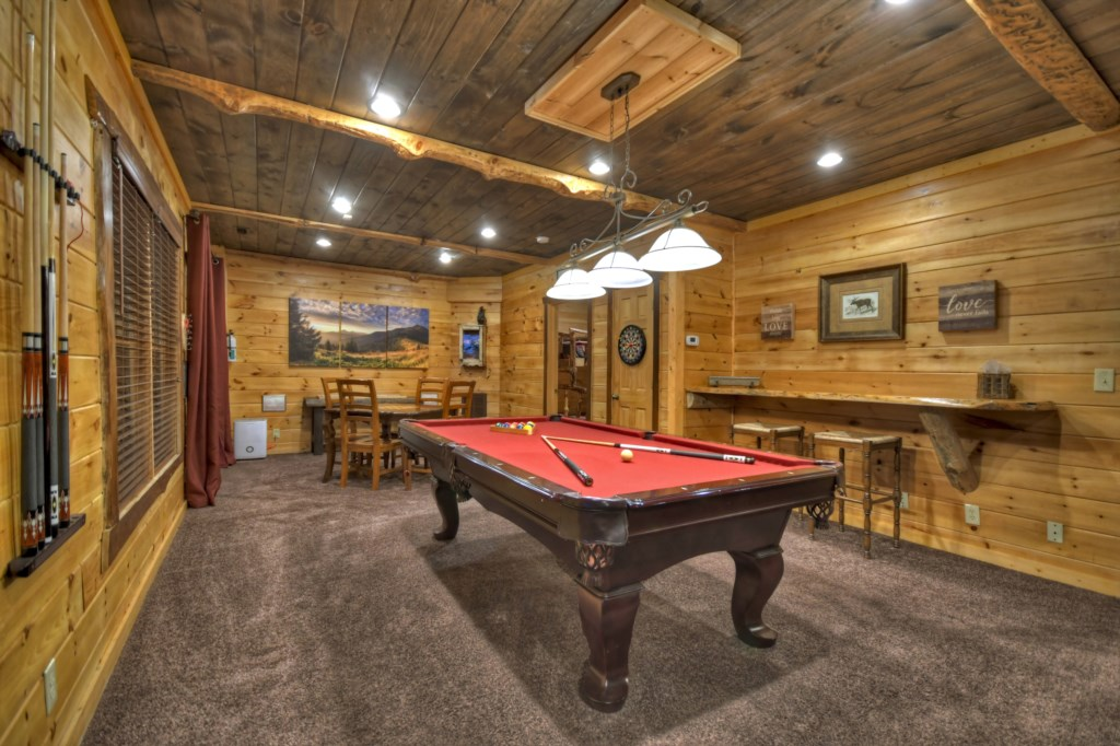 Game Room with table ideal for board games, along with bar area
