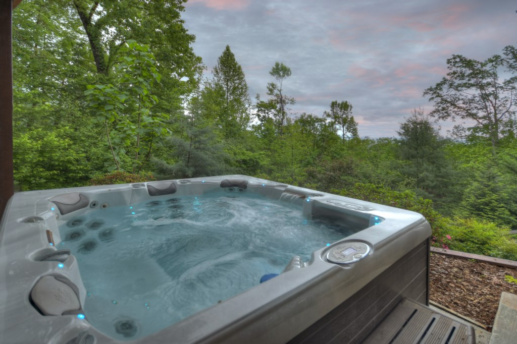Relax and unwind in the hot tub and take in the exspansive views