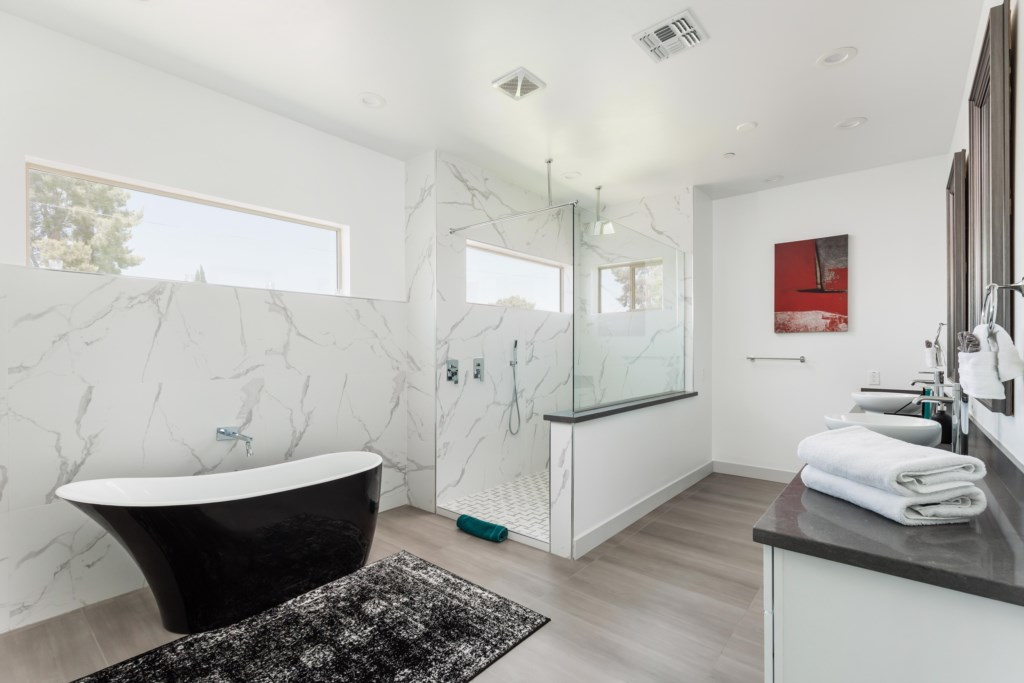 Master bath with soaking tub and walk in shower