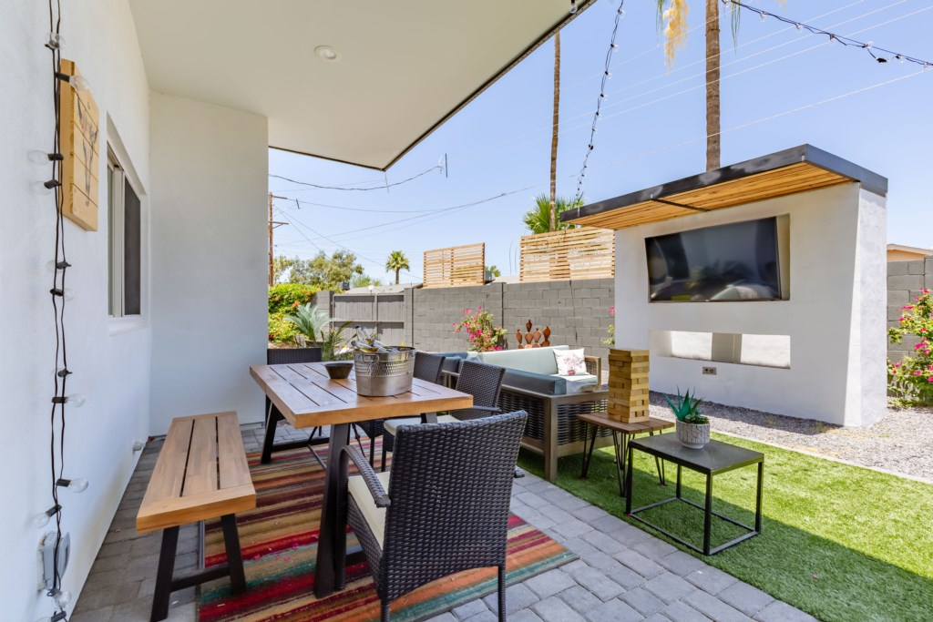 Outdoor TV with dining and patio furniture