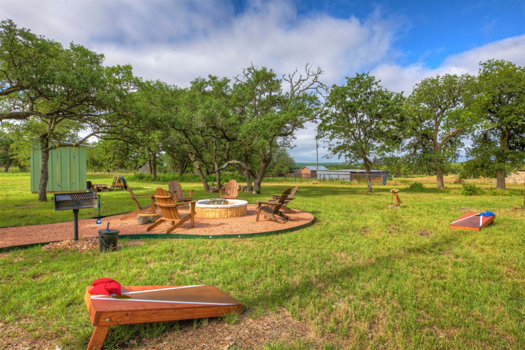The property is equipped with a fire pit, grill, a cornhole set, and croquet for group fun!