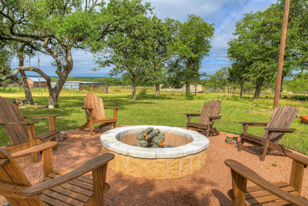 Outdoor view of the Oak Cottage Photo with Fire Pit and Chairs 4 of 5