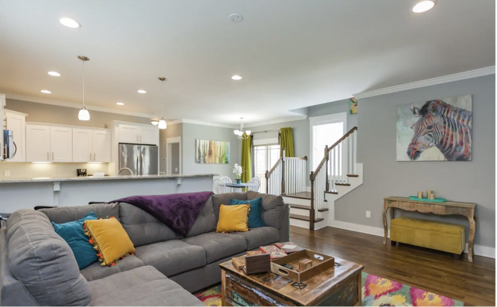 This bright and spacious living room has ample seating for all your guests. (note extra seating bench under entry table)