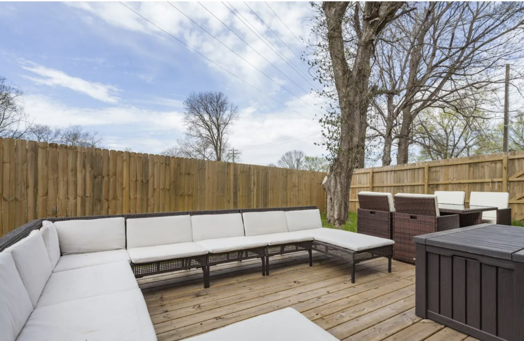 Outdoor table and tons of lounging space.