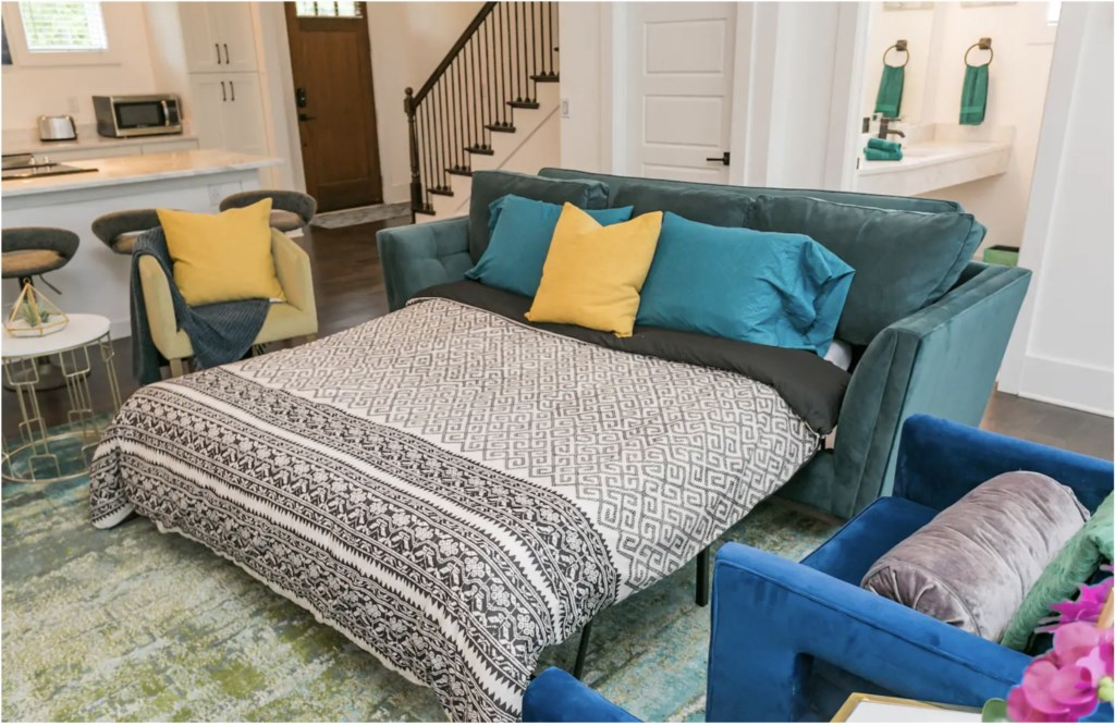 The couch pulls out to a comfy bed. Linens stored in the laundry room
