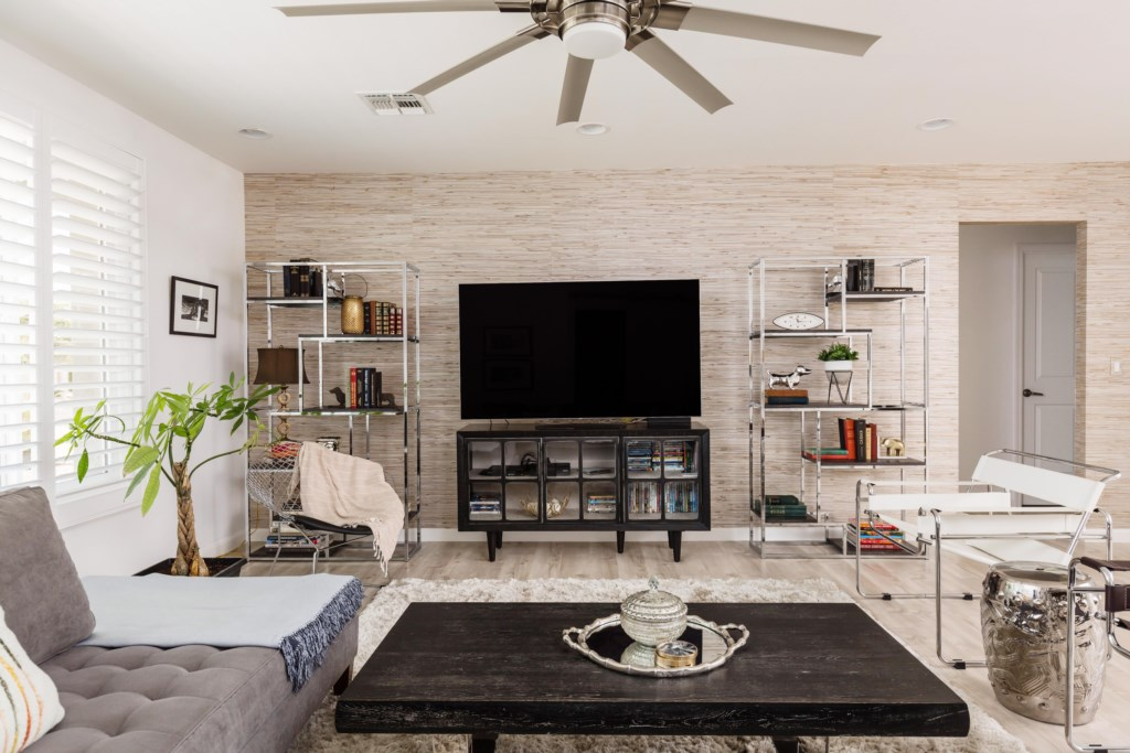 Open concept living room with large flat screen TV