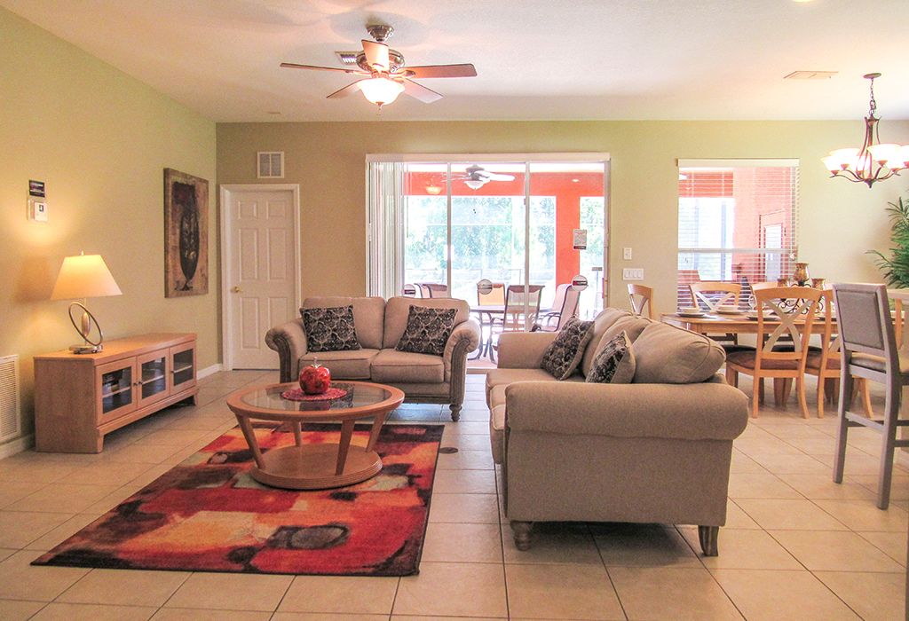 Very comfortable and spacious family room, adjacent to the pool and kitchen.