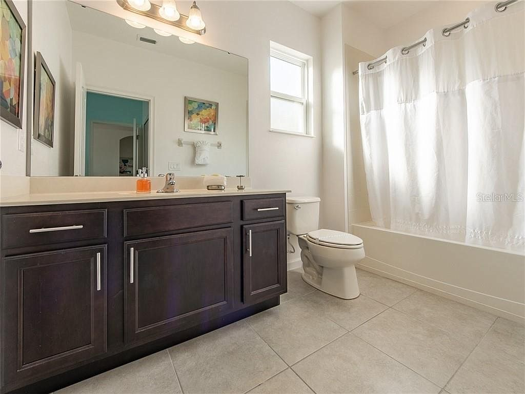 Bathroom 4 -  Private en suite Bathroom off of Bunk Bed Room with shower/tub combo, toilet, single sink (upstairs)