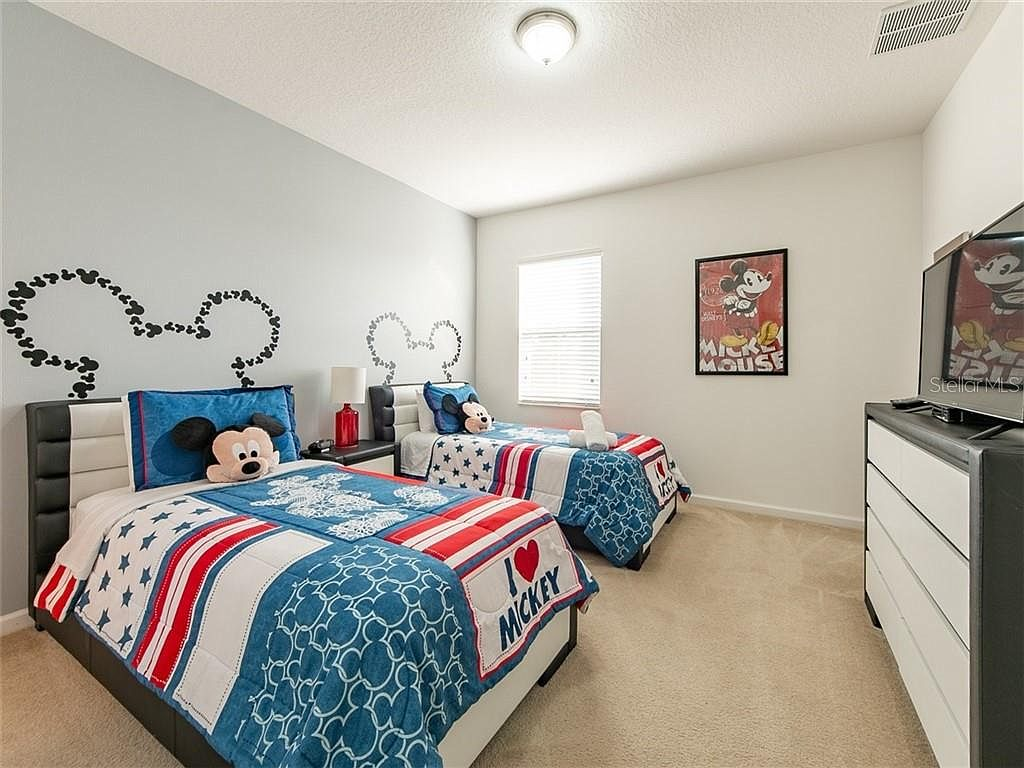 Bedroom 6 - Two Twin Beds with Mickey Theme featuring private en suite bathroom with shower/tub combo (upstairs)