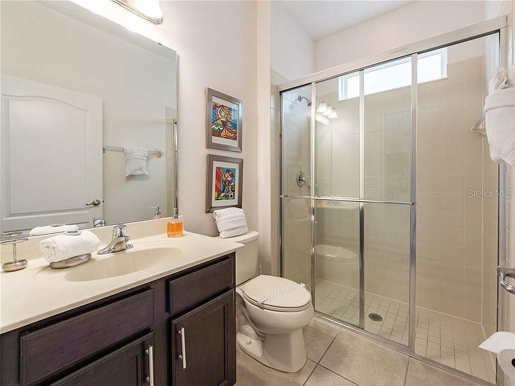Bathroom 1 - Hallway Bath featuring Walk In Shower, Single Sink and Toilet (downstairs)