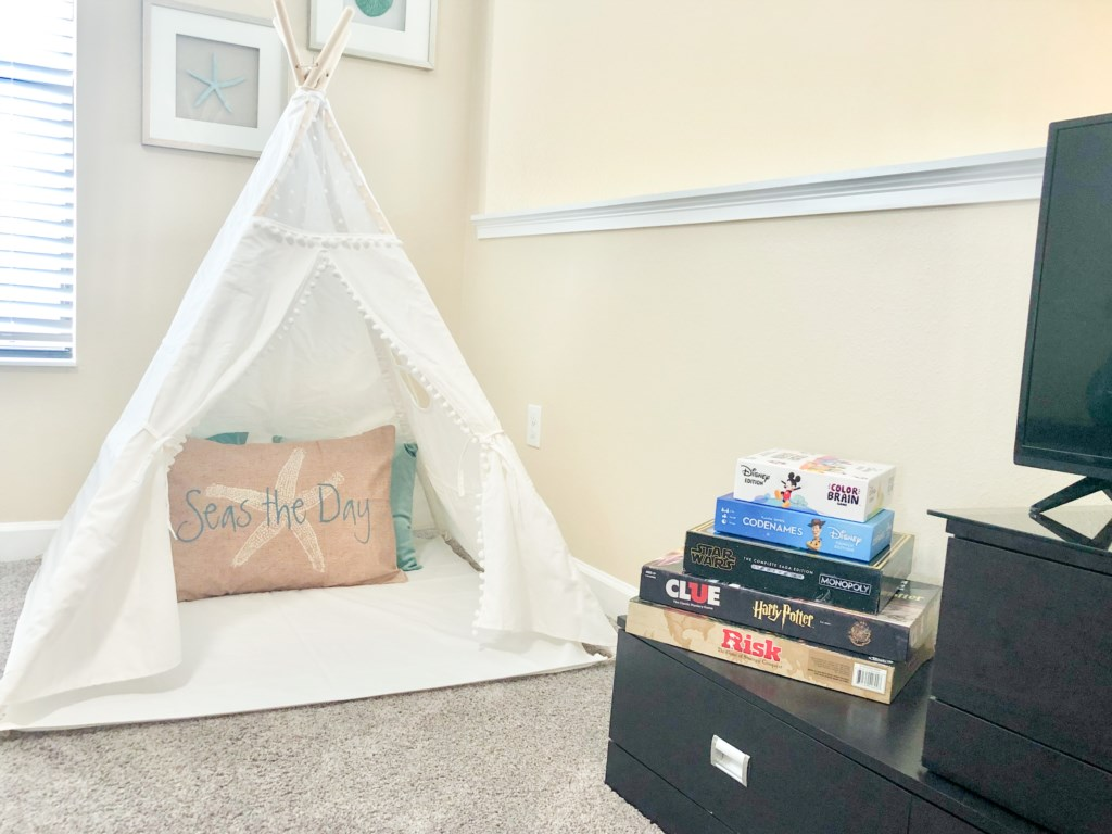 Adorable tent for kids with assorted games!