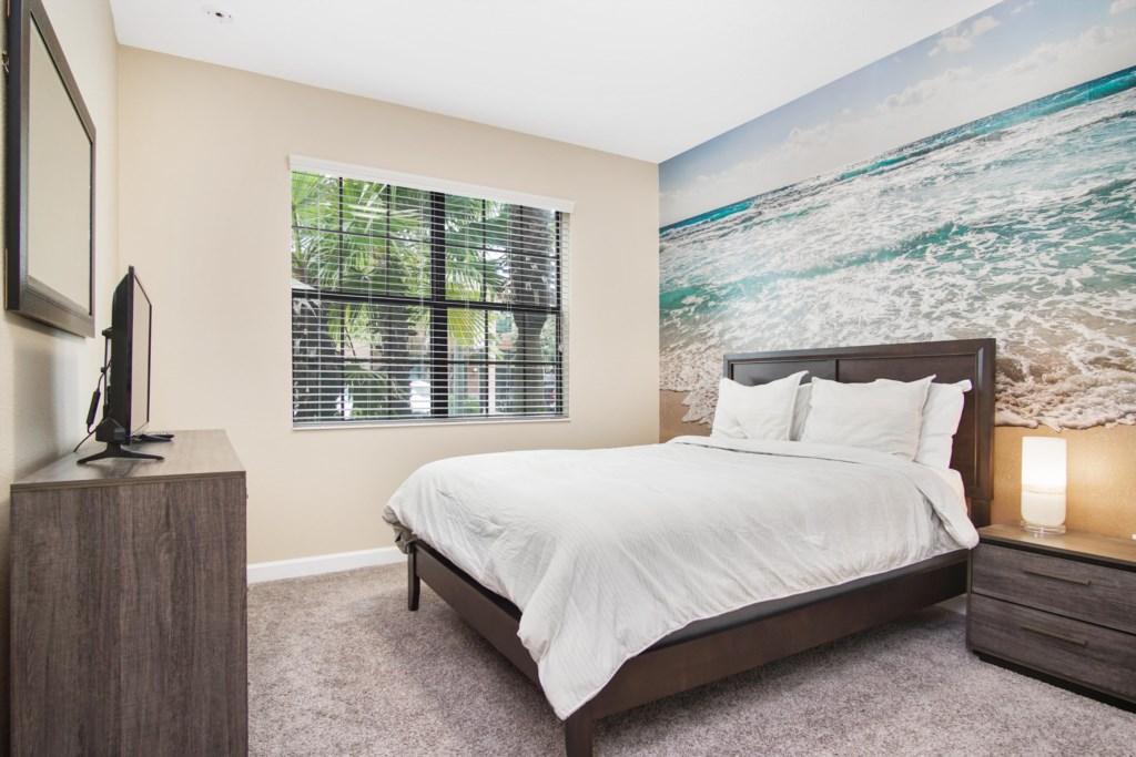 "Downstairs | Bedroom 1 - Queen Bed with 42"" TV (Ocean themed)"