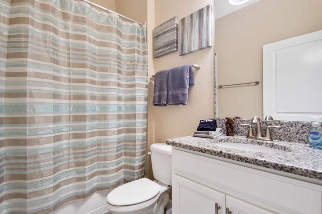 Downstairs | Bathroom 1 - Hallway Bath: shower/tub combo, single sink.