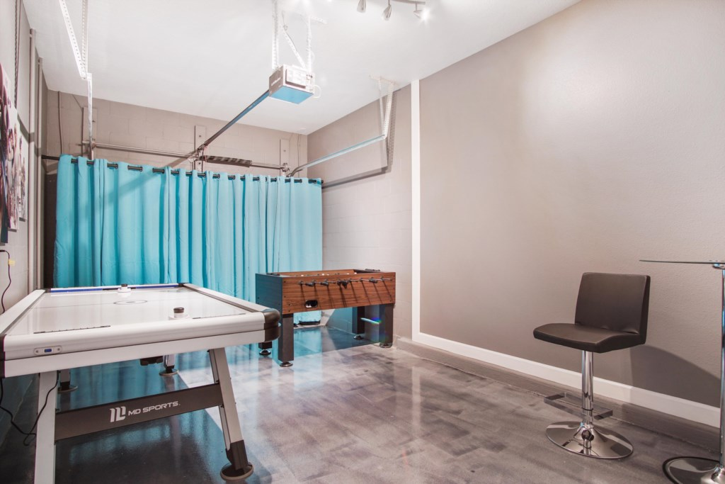Beautifully finished Games Room featuring Air hockey, darts, and foosball.