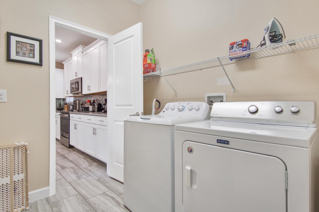 Full size washer and dryer in the laundry room. There are also pool towels as well as an iron and board.